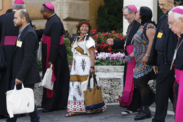 Bishops and lay participants leave the first session of the Synod of Bishops for the Amazon at the Vatican Oct. 7, 2019. The first week of the Synod of Bishops for the Amazon saw support for key synod themes emerge, including the priestly ordination of married indigenous men, impassioned pleas for respect for indigenous culture and denunciations of violence against the Earth.(CNS/Paul Haring)