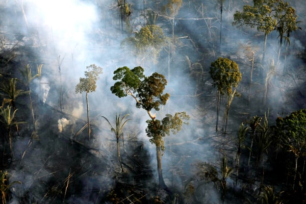 Smoke billows during a fire in an area of the Amazon rainforest near Porto Velho, Brazil. The Amazon Synod at the Vatican in October considered the environmental impact on the Amazon forest and its people. (CNS/Bruno Kelly, Reuters/Brazil)
