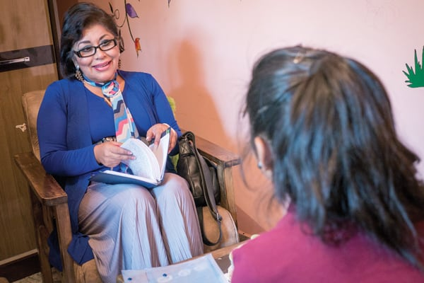 At Hogar Nuestra Casa, Dr. Elizabeth Patiño Durán, psychotherapist, evaluates a young girl who was abused by her father repeatedly until she entered the shelter four years ago. (Nile Sprague/Bolivia)