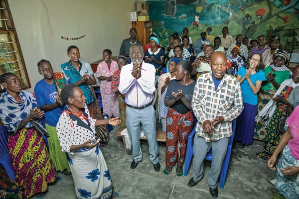 "After a support group meeting, members of Uzima Centre sing a praise song: ""May he be lifted up, our God, today. May he be lifted up, the Lord of lords."" (J. Fleury/Tanzania)"