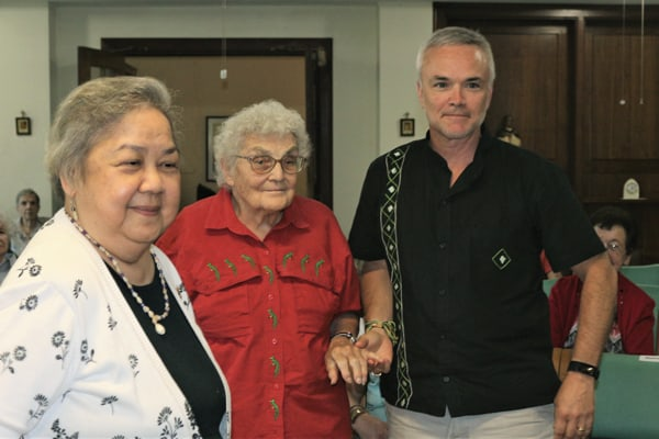 Maryknoll Sisters Vice President Norie Mojado (l.) congratulates Sister Marion Puszcz and Affiliate Richard Lessard on becoming prayer partners for Bangladesh. (S. King/U.S.)