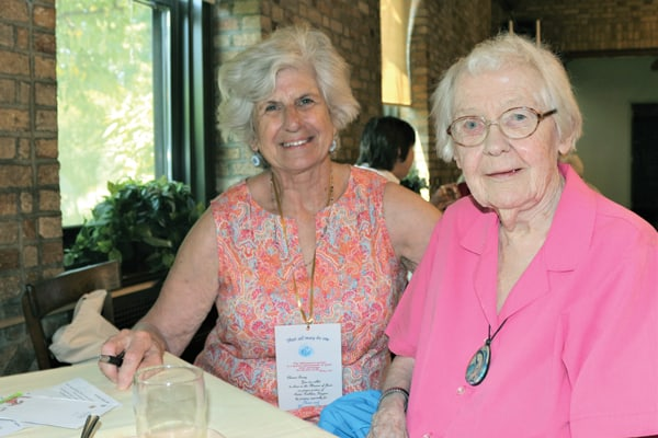 Maryknoll Affiliate Eleanor Tunny (l.) and Maryknoll Sister Kathleen Higgins get to know each other before becoming prayer partners at a commissioning ceremony at the Maryknoll Sisters center. (S. King/U.S.)