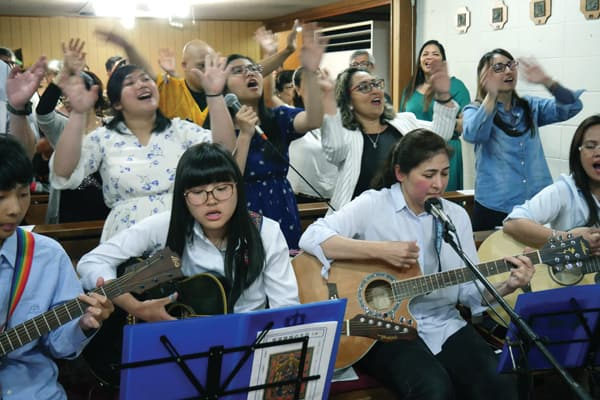 A choir, formed by immigrants in Japan, sings at the Infant Jesus Church in the city of Iga-Ueno, where Father Rodriguez serves as pastor. (P. Saunders/Japan)