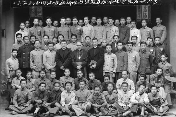 Maryknoll Bishop Francis X. Ford with students and teachers of Kaying Newman Hall, a hostel for Catholic high school students in Kaying (Meixian), China, circa 1940. (Maryknoll Mission Archives)