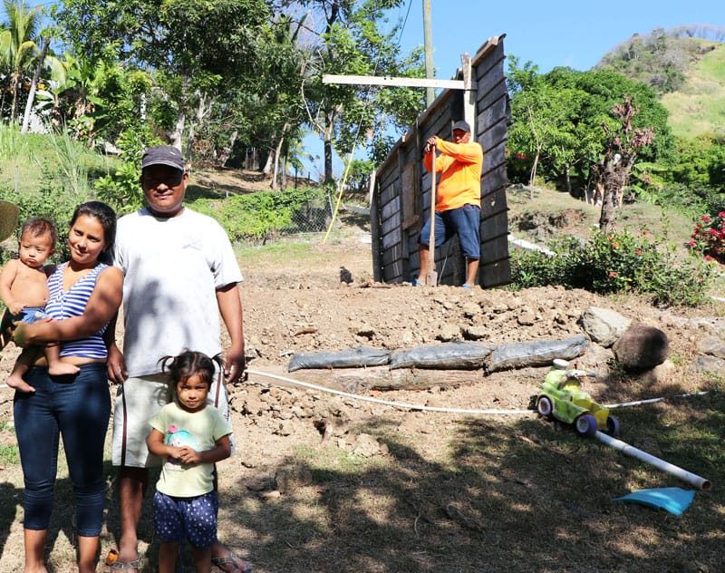 The Franco family shows the sister Heramil the land where They will build their new house.