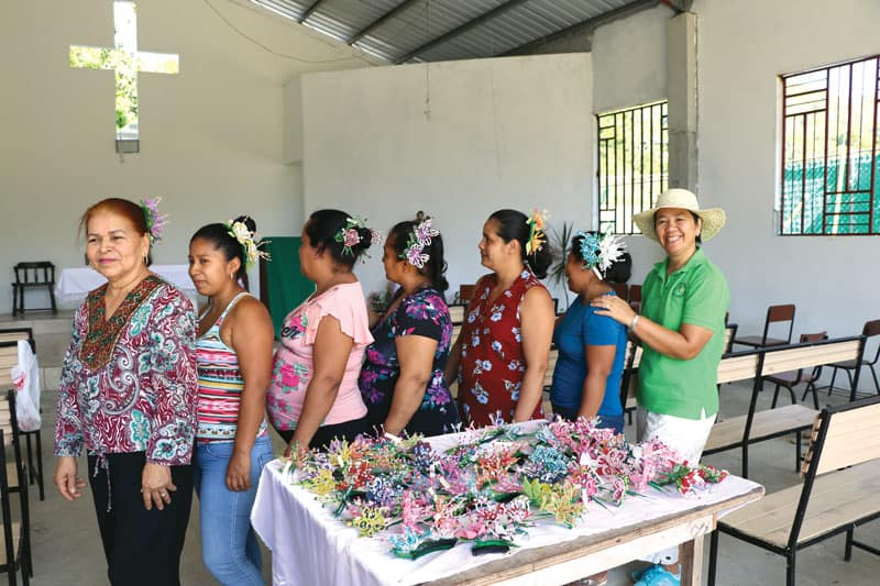 Women from the community of Vallecito show handicrafts they learned to make to sell locally.