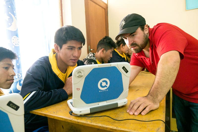 Volleyball Values: Juan Gomez teaching Jesus Puma in computer class. (Nile Sprague/Bolivia)