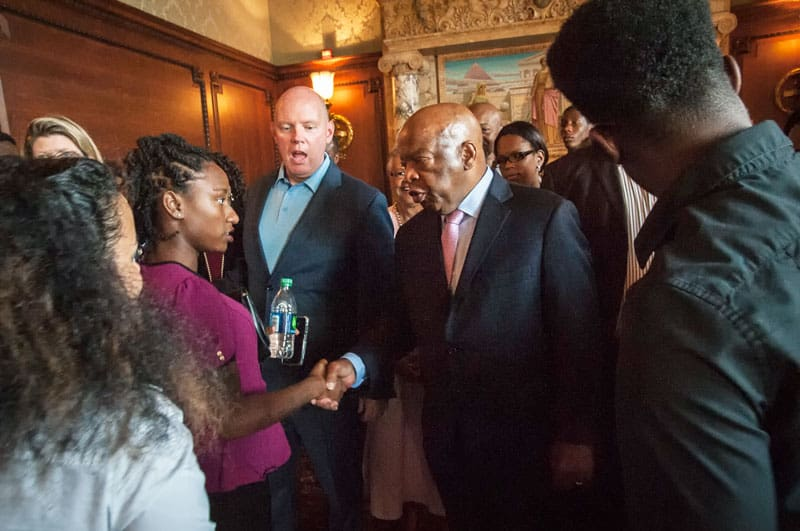 U.S. Rep. John Lewis, D-Ga., greets a young homeless woman at the Library of Congress in Washington. Lewis and other civic leaders shared lessons with formerly homeless on how the government works with a group of young people visiting Washington from Covenant house facilities around the U.S. (CNS/courtesy Covenant House)