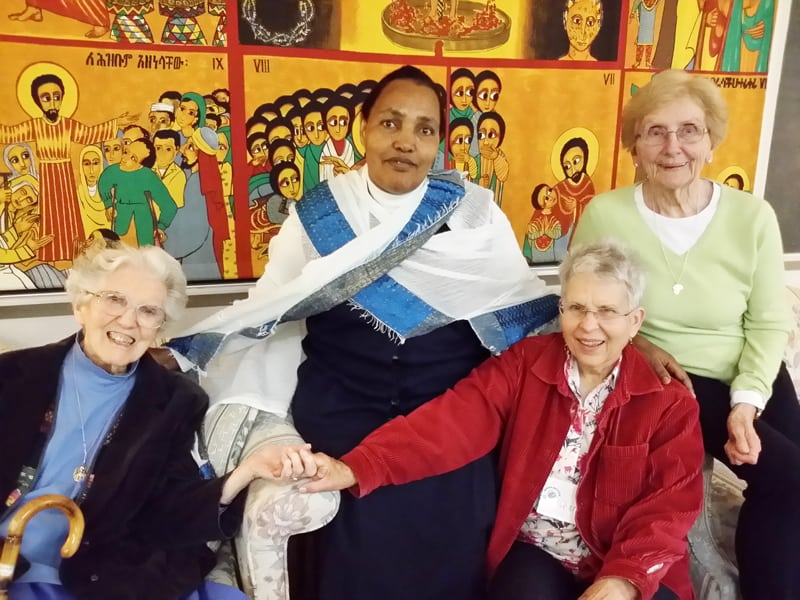 At a Maryknoll Mission Institute program (l. to r.) Maryknoll Sister Madeline Dorsey, Missionary Sister of the Sacred Heart Sister Adanech from Ethiopia, Maryknoll Affiliate Charlotte Cook and Maryknoll Sister Josephine Kollmer participate in a small group. (Courtesy of Maryknoll Sisters/U.S.)