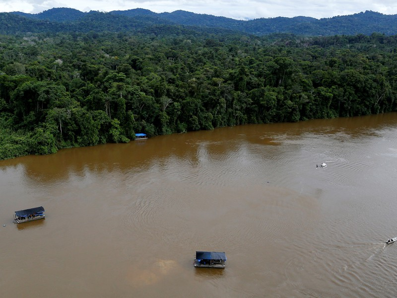 Querida Amazonia: A gold dredge is seen at the banks of Uraricoera River during Brazil's environmental agency operation against illegal gold mining on indigenous land, in the heart of the Amazon rainforest, April 15, 2016. (CNS photo/Bruno Kelly, Reuters)