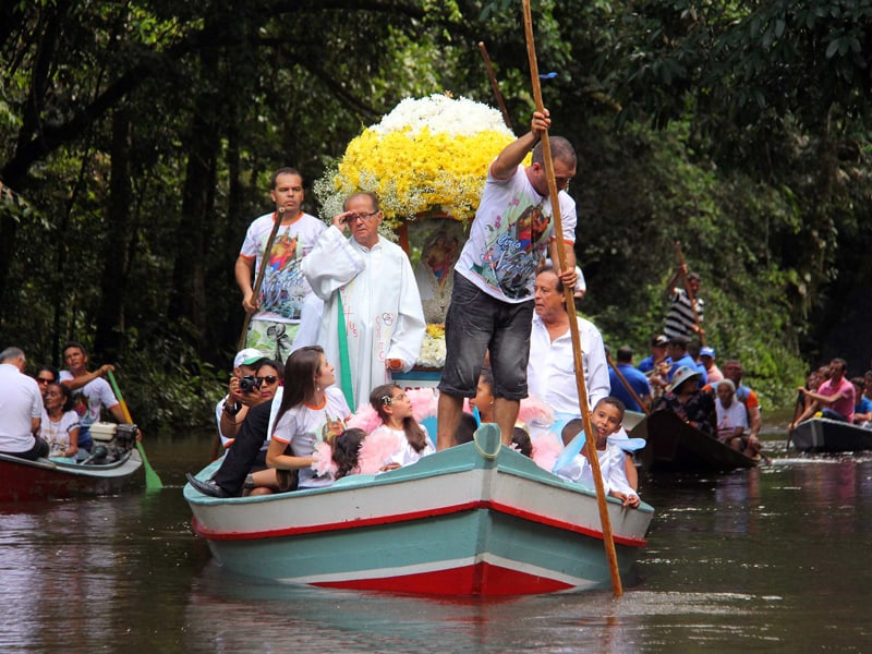 "Querida Amazonia: Pilgrims travel in boats as they accompany the statue of Our Lady of Nazareth during an annual river procession and pilgrimage along the Apeu River to a chapel in Macapazinho, Brazil, Aug. 3, 2014. The Vatican released Pope Francis' postsynodal apostolic exhortation, ""Querida Amazonia"" (Beloved Amazonia), Feb. 12, 2020. (CNS photo/Ney Marcondes, Reuters)"
