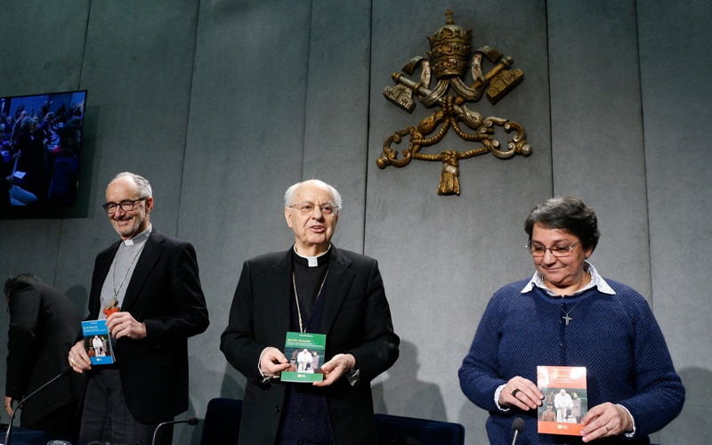 "Querida Amazonia: Cardinal Michael Czerny, Cardinal Lorenzo Baldisseri, and Sister Augusta de Oliveira hold copies of Pope Francis' apostolic exhortation, ""Querida Amazonia"" (Beloved Amazonia), during its release at a news conference at the Vatican Feb. 12, 2020. The document contains the pope's conclusions from the 2019 Synod of Bishops for the Amazon. (CNS photo/Paul Haring)"