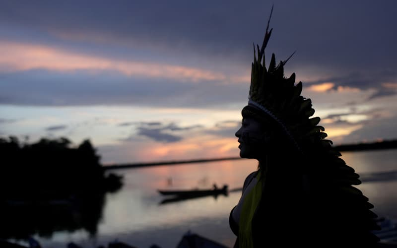 Beloved Amazonia: A leader of the Celia Xakriaba peoples walks along the banks of the Xingu River in Brazil's Xingu Indigenous Park Jan. 15, 2020. (CNS photo/Ricardo Moraes, Reuters)