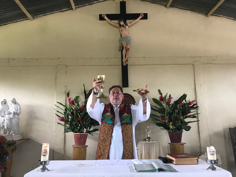 """Jesuit Father Alfredo Ferro celebrates Mass July 14, 2019, in the indigenous community of Nazaret, Colombia. In Pope Francis' postsynodal apostolic exhortation, """"Querida Amazonia,"""" released Feb. 12, 2020, the pontiff acknowledged the serious shortage of priests in remote areas of the Amazon, but he insisted not all avenues have been exhausted to address the issue. (CNS photo/David Agren)"""
