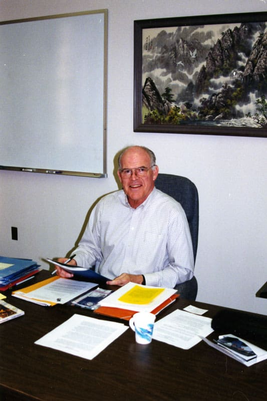 General Council member Fr. Henehan sits in his office at the Maryknoll Center, 2001. (Maryknoll Mission Archives)