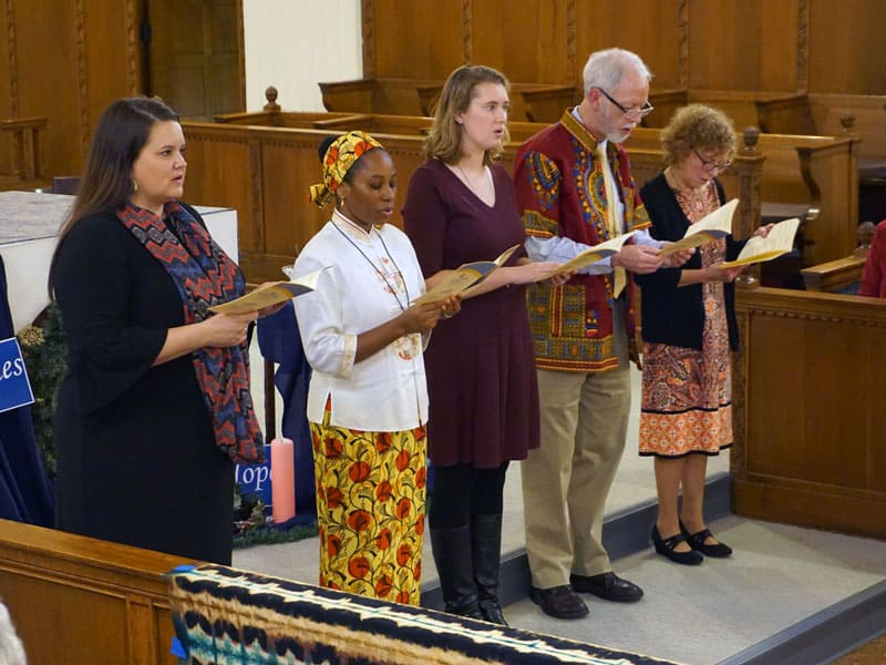 Five new Maryknoll missioners read their commitment prayer during their Joint Mission Sending Ceremony in December 2019. (Meinrad Scherer-Emunds/U.S.)
