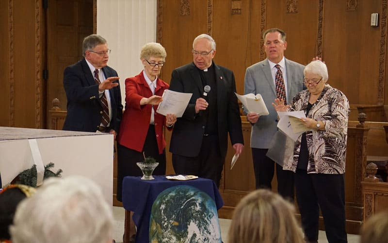 Leaders of the four Maryknoll entities participate in the sending of five new Maryknoll missioners in December 2019. Pictured, from left, are Bob Short of the Maryknoll Affiliates, Sister Antoinette Gutzler of the Maryknoll Sisters, Father Raymond J. Finch of the Maryknoll Fathers and Brothers, and Ted Miles and Marj Humphrey of the Maryknoll Lay Missioners. (Meinrad Scherer-Emunds/U.S.)
