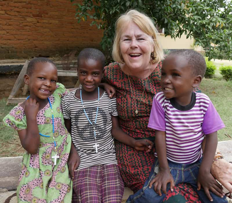 "Maryknoll Lay Missioner Elizabeth ""Liz"" Mach enjoys time with young children at the Jipe Moyo shelter, which protects children in danger of gender-based violence. (Sean Sprague/Tanzania)"