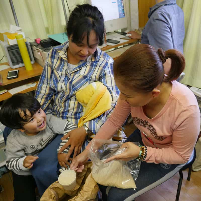 Two immigrant women in Japan, who were victims of domestic violence, attend the Kalakasan center where they receive services and a sense of community. (Peter Saunders / Japan)
