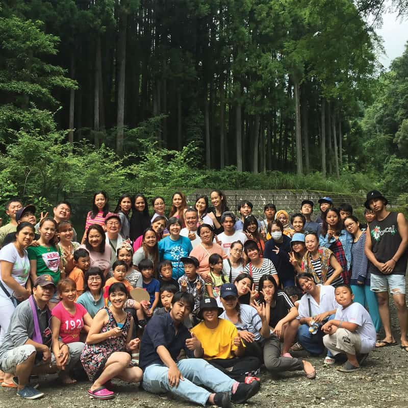 Staff and volunteers of a center for the empowerment of abused women in Japan, at an outing with the women's families. (Courtesy of Kalakasan Center)