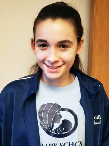 Mairead Reitzel, an eighth-grader at St. Mary School in East Islip, N.Y., wins third place in Division I of Maryknoll Student Essay Contest 2019.