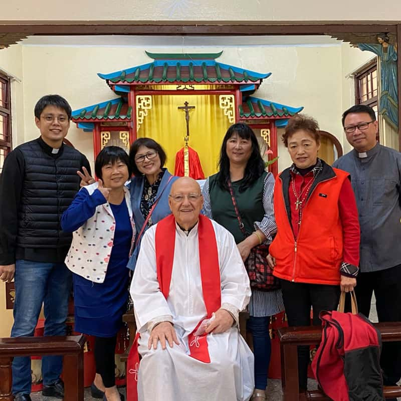 Father Murray (center) smiles with parishioners and priests in residence after Mass at Our Lady of China Church in Taichung.(Courtesy of Our Lady of China Church/Taiwan)