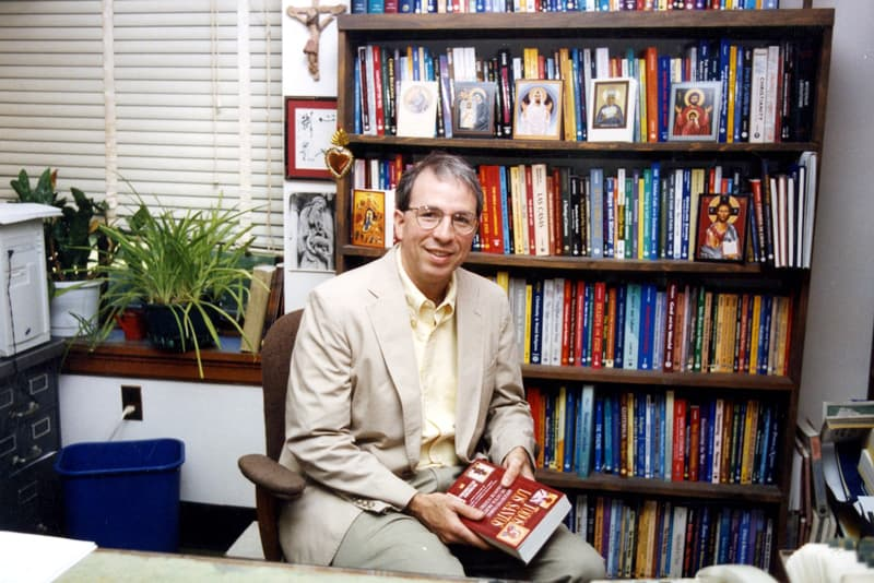 Robert Ellsberg, Orbis publisher and editor-in-chief, holds his book All Saints: Daily Reflections on Saints, Prophets, and Witnesses for Our Time. (Courtesy of Robert Ellsberg)