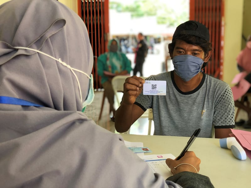 Catholic Relief Services' money distribution in Palu, Indonesia, to vulnerable families needing cash to retrofit houses damaged in a 2018 tsunami continues, despite the COVID-19 pandemic. (CNS photo/Prillimala Angelisca, courtesy CRS)
