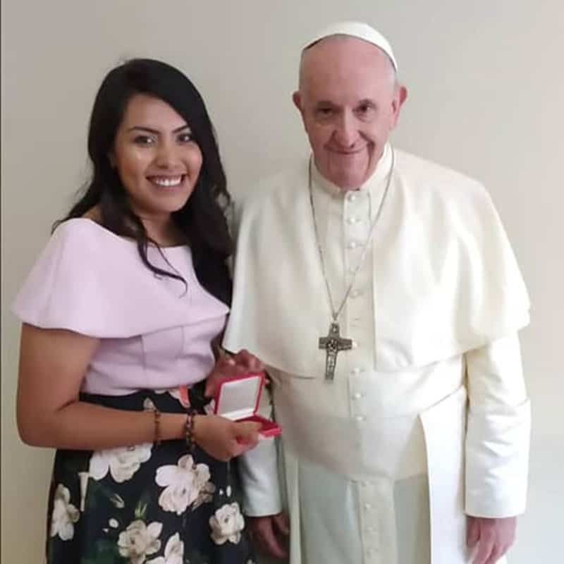 Brenda Noriega poses with Pope Francis for a photo at World Youth Day in Panama, 2019. (Photo provided by Brenda Noriega/Panama)