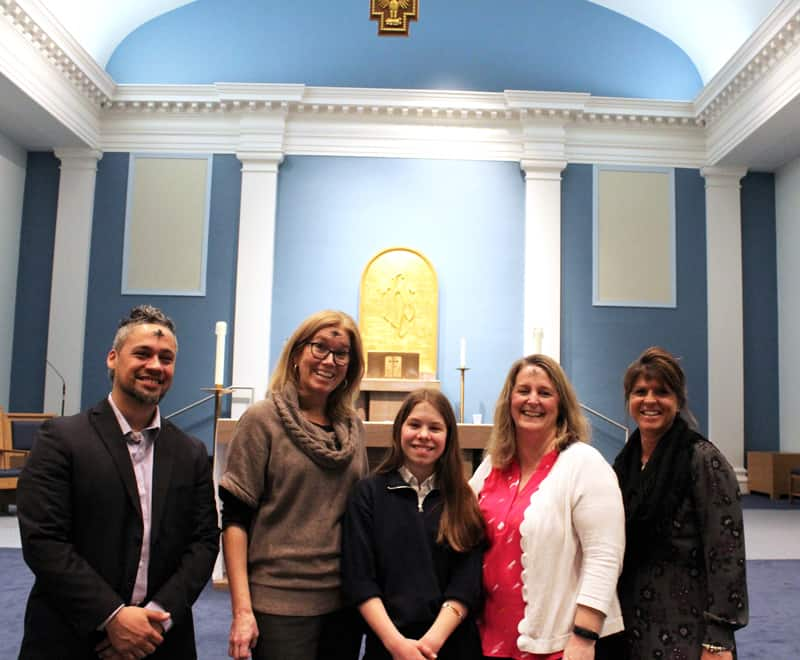 After receiving her first-place award for Division I in Maryknoll Student Essay Contest 2019 on Ash Wednesday, Tatiana Orsburn gets kudos from (l. to r.) Maryknoll mission promoter Walter Hidalgo, teacher Kelly Updike, principal Stephanie Rattell and assistant principal Terry Ferro. (Taylor Stillings/U.S.)