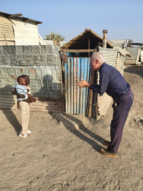 Maryknoll Father Michael Bassano, the only priest ministering at a United Nations' camp for the Protection of Civilians in Malakal, was given special permission to go walking in the camp—while keeping to social distancing protocols. (Courtesy of Michael Bassano/South Sudan)