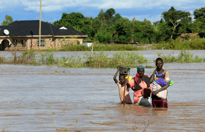 Ahead of Coronavirus, Starvation Stalks East Africa: Residents wade through floodwaters in Budalangi, Kenya, May 3, 2020. At least 100 are dead and thousands homeless after heavy rains and thunderstorms led to severe flooding and landslides across Kenya. (CNS photo/Thomas Mukoya, Reuters)
