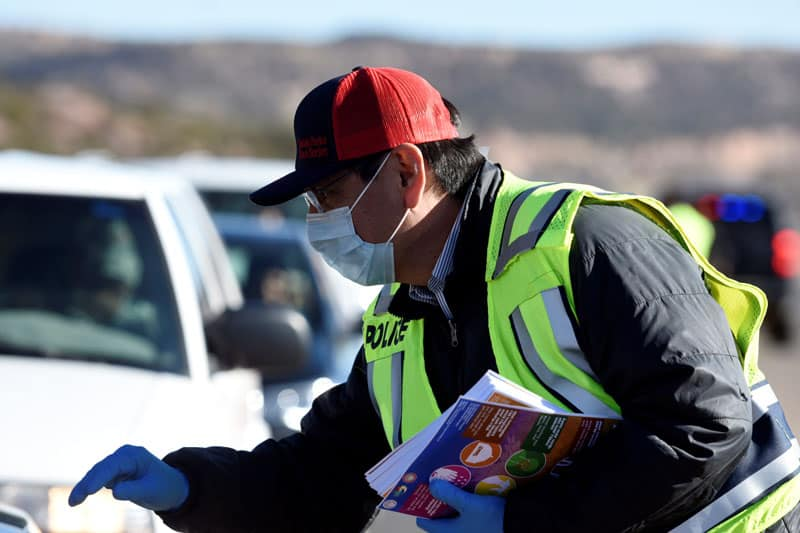 Jonathan Nez, Navajo Nation president, distributes educational material March 24, 2020, to drivers in Window Rock, Ariz., on how to prevent the spread of COVID-19, the disease caused by the coronavirus. (CNS photo/Donovan Quintero, Reuters)