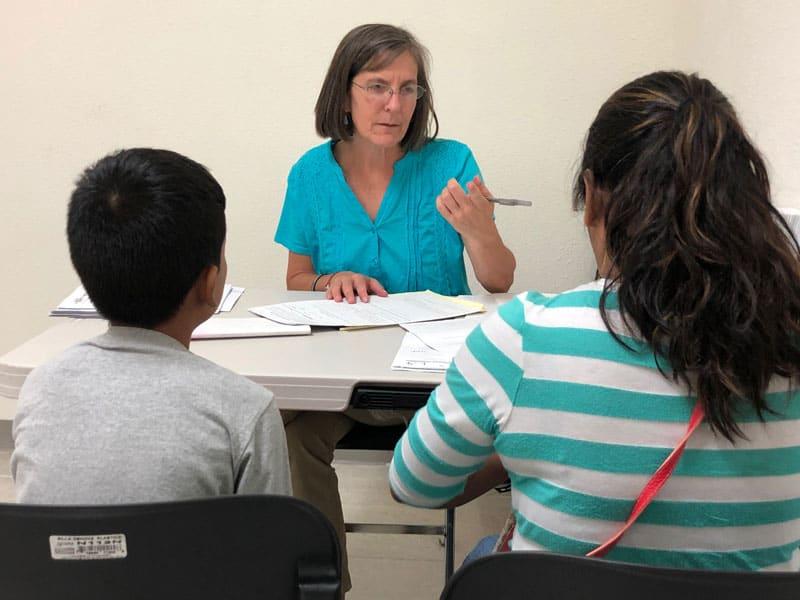 Maryknoll lay missioner fights for safety for detained migrant women in El Paso.: Heidi Cerneka, pro bono attorney for detained migrants through Las Americas Immigrant Advocacy Center, talks to clients  in El Paso, Texas.