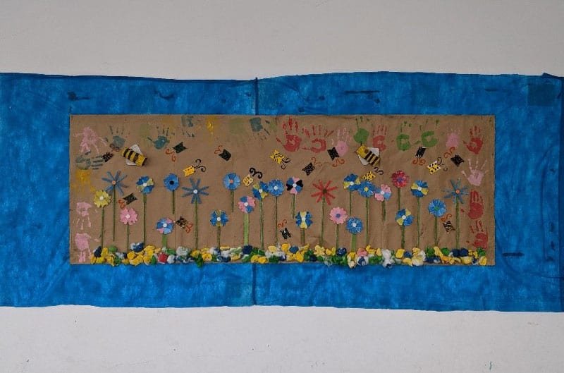 Brazil environmental impact: A mural created by Claire Stewart's students entirely from trash.