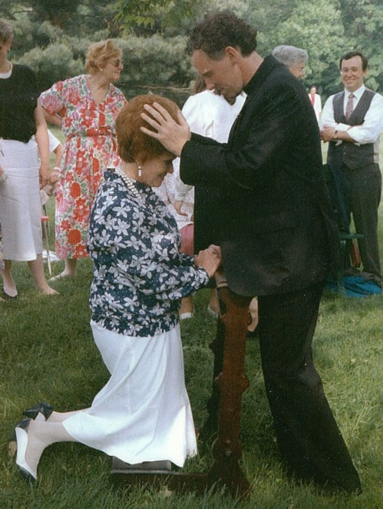 Father Sleyman blesses his mother on his ordination as a Maryknoll priest in 1990. (Courtesy of Kenneth Sleyman/U.S.)