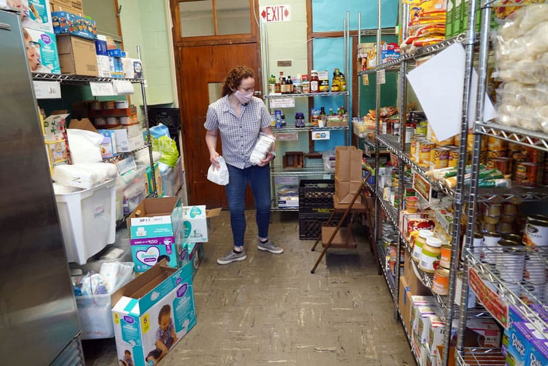 Anne O'Malley, a volunteer with the North Fork Spanish Apostolate in Riverhead, N.Y., gathers food and other necessities for distribution to people in need at the apostolate's outreach center May 21, 2020, amid the COVID-19 pandemic. Christians are called by God to take part in the church's mission in the world to help those impacted by the coronavirus pandemic, Pope Francis wrote in a message for World Mission Sunday 2020. (CNS photo/Gregory A. Shemitz)