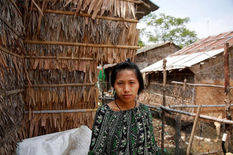 """A young woman is pictured in a file photo near her hostel in Yangon, Myanmar. Young activists in Myanmar have opened a campaign to end the use of the word """"Kalar,"""" often used as a racist term for people with dark skin. (CNS photo/Myat Thu Kyaw, Reuters)"""