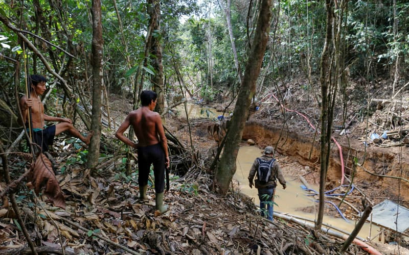 Yanomami are seen in a file photo following members of Brazil's environmental agency during an operation against illegal gold mining on indigenous land in the heart of the Amazon rainforest. (CNS photo/Bruno Kelly, Reuters)