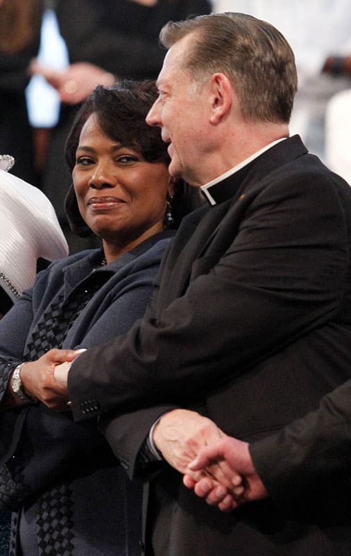 "A file photo shows the Rev. Bernice King, daughter of the Rev. Martin Luther King Jr., center, alongside Father Michael Pfleger, pastor of St. Sabina Parish in Chicago, as they sing ""We Shall Overcome"" during a service in honor of her father at Ebenezer Baptist Church in Atlanta. (CNS photo/Tami Chappell, Reuters) See VATICAN-KING-RACISM June 25, 2020."