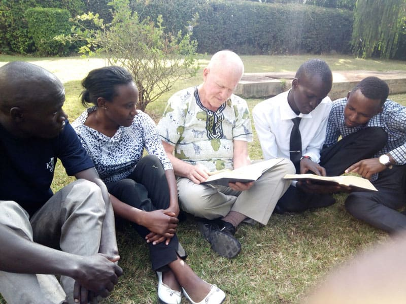 Maryknoll Father Joseph Healey discussed Bible sharing and Bible Reflection as central to Small Christian Communities with students from Kenyatta University, Nairobi, Kenya. (Courtesy of Joseph Healey/Kenya)
