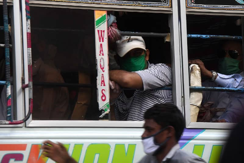 South Asia's Ticking COVID-19 Time Bomb: Passengers wearing face masks crowd a bus in Karachi on June 8. Pakistan has recorded more than 100,000 cases of coronavirus, health authorities said on June 8, as hospitals warned they are running out of beds to treat patients. (Photo: AFP, courtesy of UCAN)