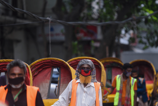 Rickshaw pullers wearing masks wait for customers in Dhaka on June 7 after Bangladesh's government loosened its coronavirus lockdown. Poor people have difficulty in being treated for COVID-19 at hospitals. (Photo: AFP)