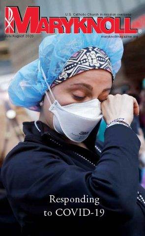 The cover of the July/August 2020 issue of Maryknoll magazine features the photo of a nurse in New York City wipes away tears in April 2020 during the coronavirus pandemic. This edition of Maryknoll magazine is available as a digital edition, online or as a downloadable pdf. (CNS/Mike Segar, Reuters)